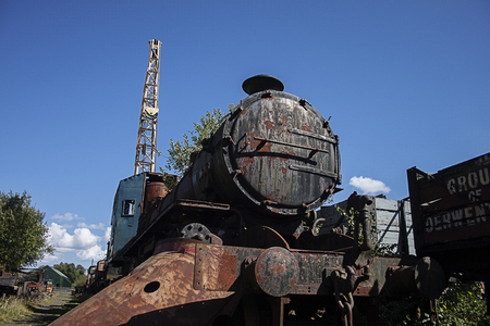 front of old steam train left abandoned and rusting