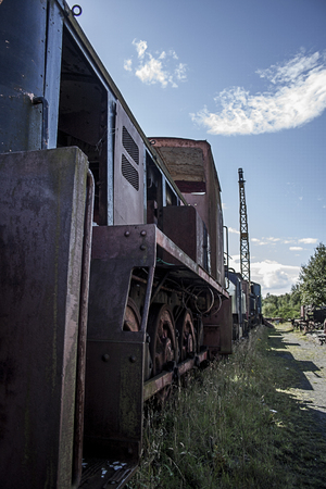 abandoned scrap diesel train rusting in yard Stock Photo