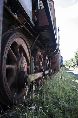 abandoned rusting stream train wheels