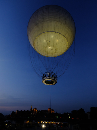malone: KRAKOW, POLAND - August 30, 2014: Tourists can watch a panorama of Krakow from the platform on the balloon, Krakow, Poland August 30, 2014. Editorial