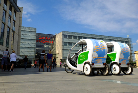 malone: KRAKOW, POLAND - August 9, 2014: Rickshaws in front of the entrance to the Krakow Gallery. Rickshaws are the most popular Means of transport in Krakow.