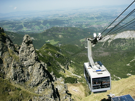 switchback: TATRA, POLAND - 9 June 2014: Polish Tatra Mountains, near the town of Zakopane, view from the top of the mount Kasprowy on a cable car PKL - Polish Railways Rope