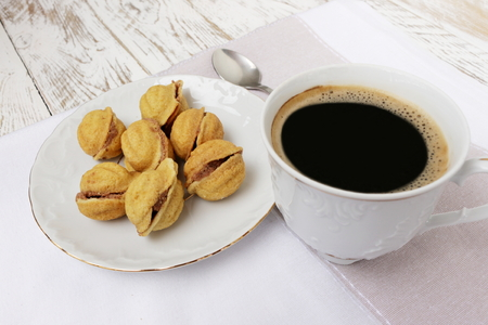counrty: homemade peanut biscuits with nut cream and a cup of coffee Stock Photo