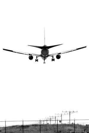 bw: An airplane landing, B&W Stock Photo