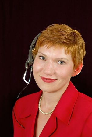 Call center operator with headset and perl necklace. Stock Photo