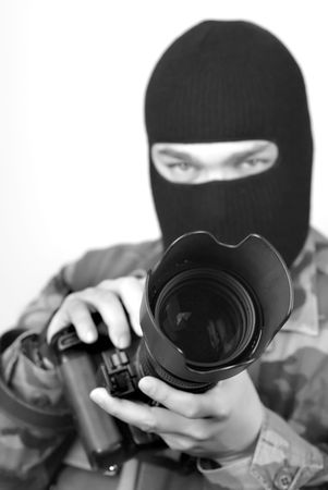 special service agent: Special Ops Photographer. Lens hood and front of lens are in focus, rest is soft