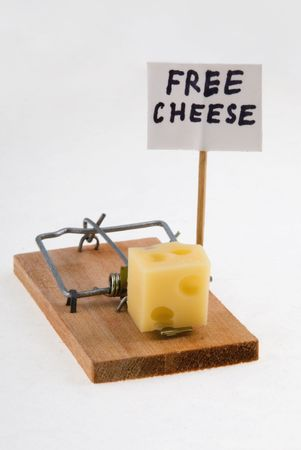 baits: Mouse trap with cheese and Free Cheese sign. Stock Photo
