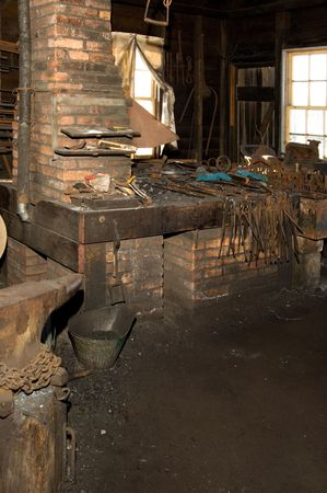 blacksmith shop: Interior of old blacksmith shop with forge and anvil