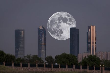Views of the moon between the four towers of Madrid