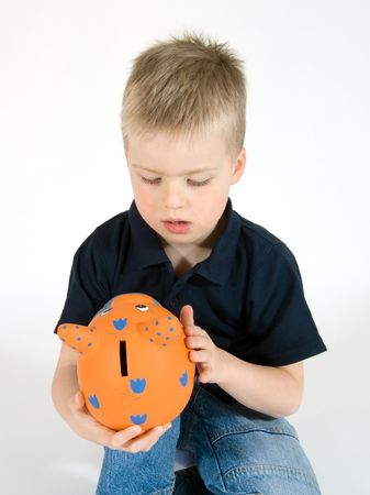 certitude: young boy stroking his orange piggy bank