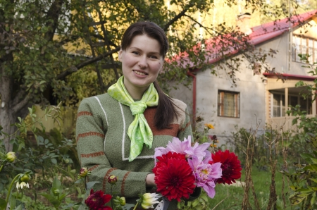Young woman cuts dahlias in the fall garden. Russia. Moscow. the last days of September. Stock Photo - 15645305