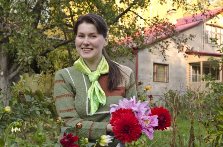 Young woman cuts dahlias in the fall garden. Russia. Moscow. the last days of September. Stock Photo - 15645322