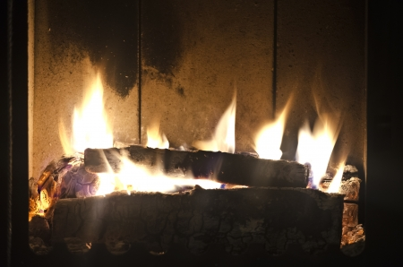woodburning: Fire in the furnace. Wood-burning stove home.