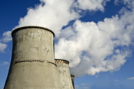 pairs on the three cooling towers - coolers thermal power Stock Photo