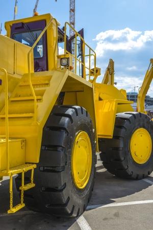 Yellow powerful new road building wheeler