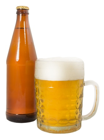 bottle of beer and a full beer mug isolated on a white background photo