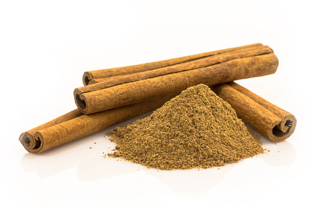 cinnamon spice - a powder and tube of dried bark Stock Photo