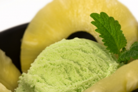 pistachio ice cream with pineapple rings and mint leaf Stock Photo