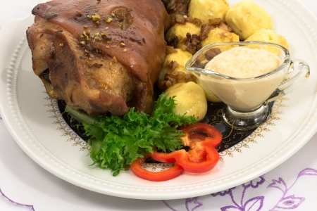grilled knuckle of pork with potato dumplings with horseradish