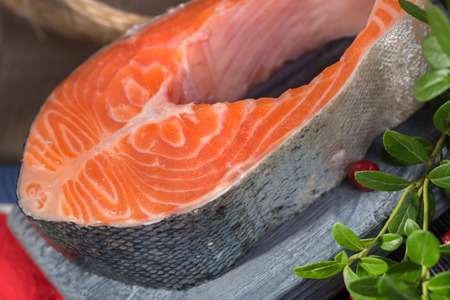 viands: Trout - Red Fish (Sweetfish, Forel), lingonberry leaves and berries Stock Photo