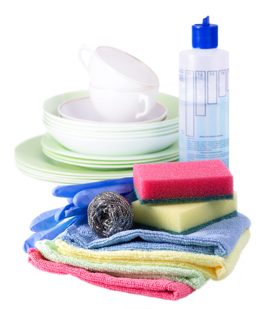 sponges, towels and dishwashing detergent isolated on white background photo