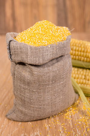 corn grits in the bag of coarse cloth and cobs