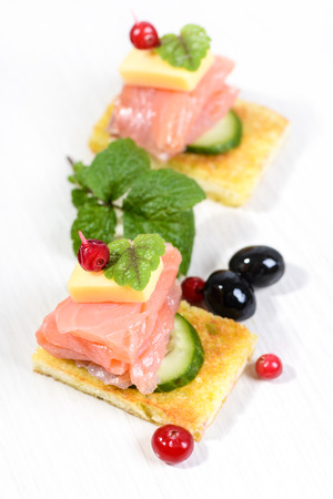 salmon with cucumber and cheese on toasted bread Stock Photo