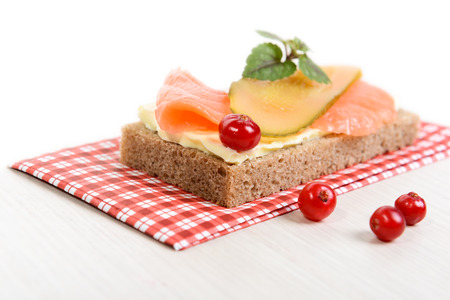 rye bread, butter, salmon and pickled cucumber Stock Photo