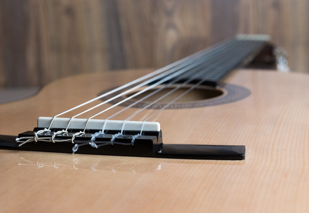 resonator: acoustic six-string guitar on the background of wooden panels Stock Photo