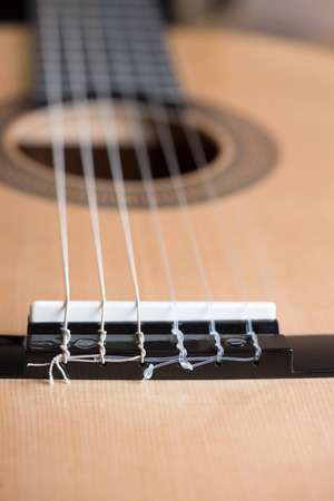 acoustic six-string guitar on the background of wooden panels Stock Photo