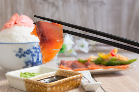 Japanese cuisine - salmon dipped in soy sauce Stock Photo