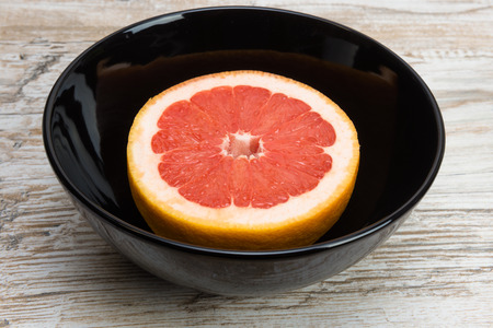 grapefruit or pomelo is a black bowl