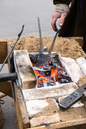 forge: old village blacksmith forge with hot coals