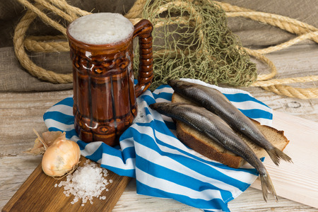 kipper: Breakfast fisherman. Baltic herring with coarse bread, beer and onion Stock Photo