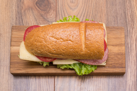 Sandwich with cheese, salami, tomatoes and lettuce