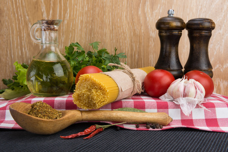 Spaghetti in packaging and ingredients for condiment Stock Photo