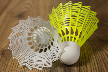 shuttlecocks for badminton white and yellow on the wooden floor