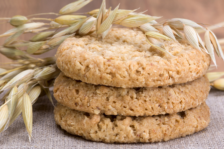 oatmeal cookie: oatmeal cookies, stalks of oats and linen fabric cloth