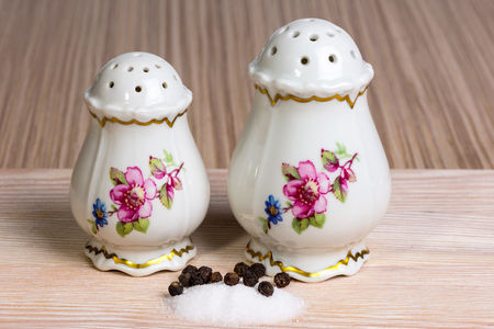 old-fashioned salt and pepper shakers on the table Stock Photo