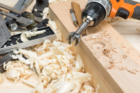 carpentry tools and wood shavings in the furniture workshop