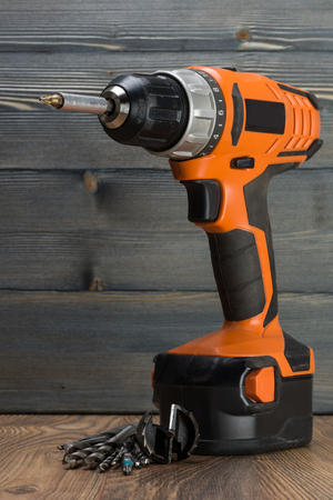 turn table: battery powered drill and drill on a wooden surface