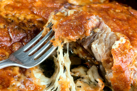 meat pork baked with cheese on a metal baking tray Stock Photo