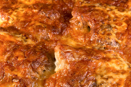 dripping pan: meat pork baked with cheese on a metal baking tray Stock Photo