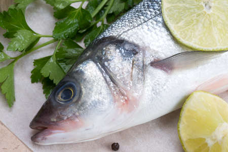 fresh fish - sea bass, pepper and lime Stock Photo