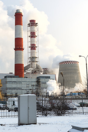electric station: electric station - combined heat and power near the city in winter time