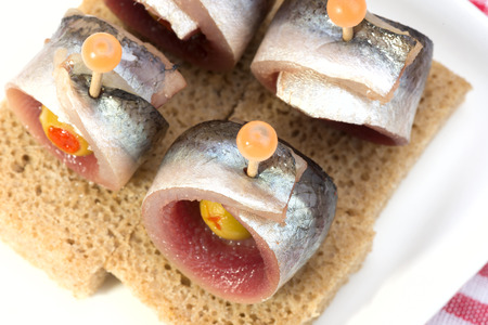 rye bread: Rolls of herring with olives on rye bread