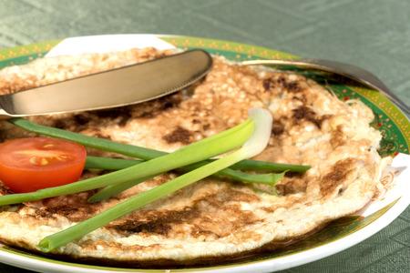 jewish cuisine: Authentic Jewish breakfast dish made of broken pieces of matzah, milk and beaten eggs pan-fried Stock Photo
