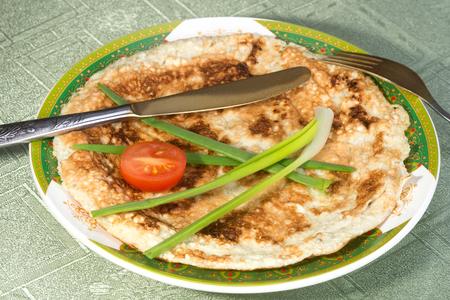 matzah: Authentic Jewish breakfast dish made of broken pieces of matzah, milk and beaten eggs pan-fried Stock Photo