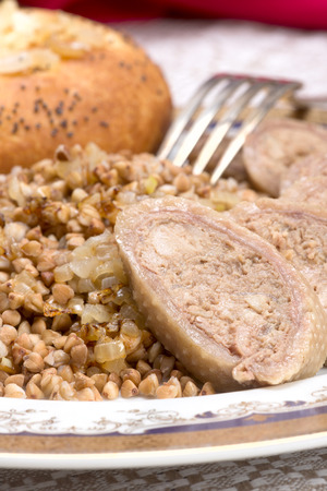 jewish cuisine: Skin of chicken neck or gooseneck, filled with chicken liver, onion, poultry fat and matzah meal, boiled in chicken bouillon and served with boiled buckwheat.