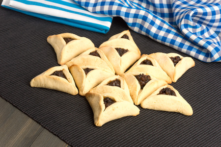 hamantaschen: On Purim, Ashkenazi Jews eat triangular pastries called Hamantaschen (Hamans pockets) or Oznei Haman (Hamans ears)